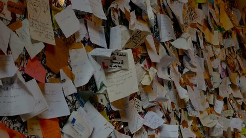 little cards with a loving dedication on the wall of Juliet's balcony