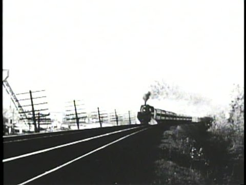NEBRASKA PRAIRIES, 1905, Archival footage of steam locomotive passing in winter