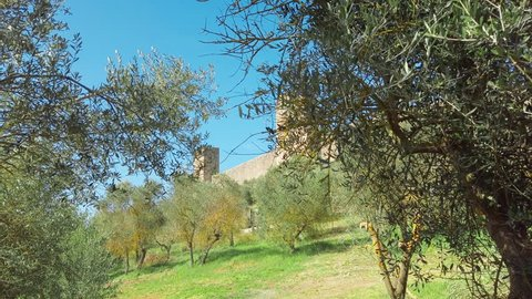 Siena, Italy: Panning gimbal panorama of medieval village of Monteriggioni within the defensive walls in Tuscany; architecturally significant, referenced in Dante Alighieri's Divine Comedy