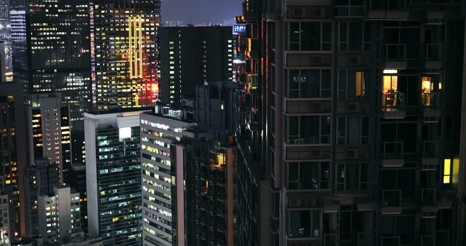 Hong Kong, China 4 SEP 2018: Dark buildings and tall skyscrapers of Hong Kong downtown district. Beautiful city lights at night urban background | Shutterstock HD Video #1026050012