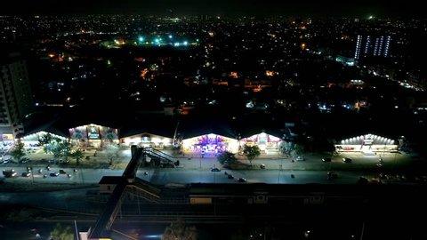 Beautiful aerial view of city and wedding banquets at night at Nazimabad, Karachi - Drone Footage Karachi City 11 02 2019
