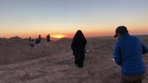 Syria - March 19, 2019: Families fleeing ISIS receive food in sunset