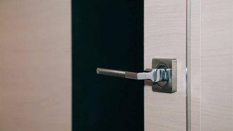 Men's hairy hand opens and closes the steel metal door HD 1920x1080.Texture.Background.