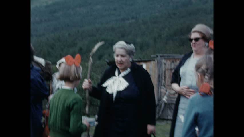 1950s: EUROPE: lady talks to children. Family sit by tent. | Shutterstock HD Video #1026123182