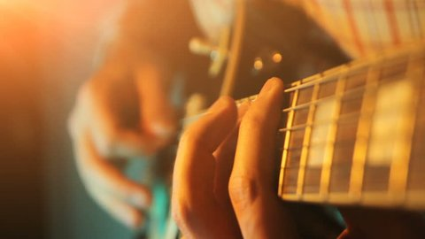 Close up of man hand playing guitar