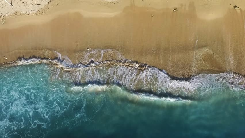 Aerial view of golden beach and foaming blue azure waves. | Shutterstock HD Video #1026199172