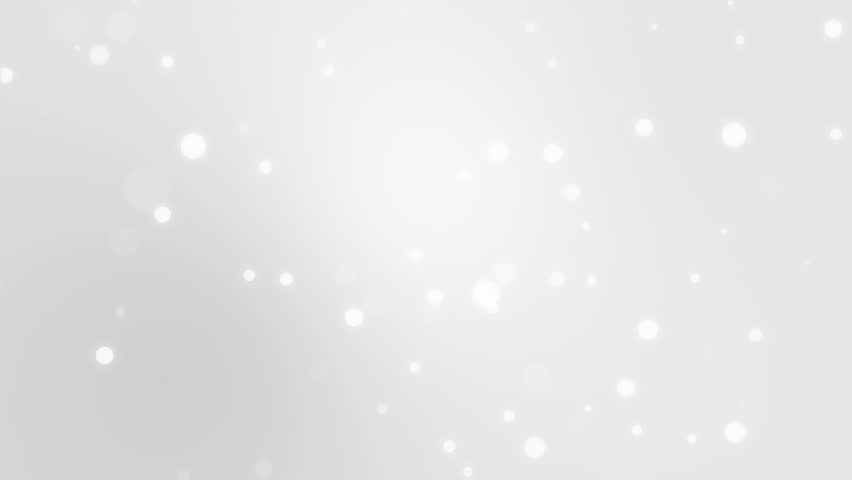 Glowing silver white bokeh background with floating light particles.