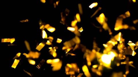 4K Realistic Golden Confetti Party Popper on a Black Background .  Super Slow Motion , Realistic Video Background ... You can use blending mode (screen).