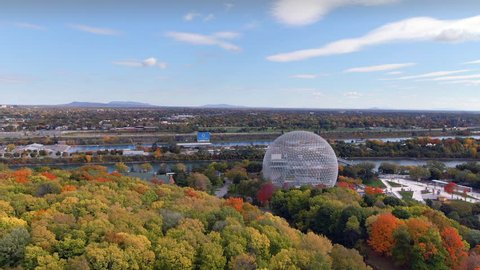 Montreal, Quebec, Canada, aerial view of the Biosphere Environmental Museum showing maple trees changing colour in Fall season.