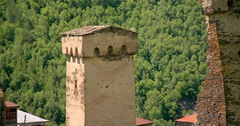 Zoom out from close up of stone medieval fortified Svaneti tower houses of Murkmeli,  near Ushguli, Upper Svaneti, Samegrelo-Zemo Svaneti, Mestia, Georgia.