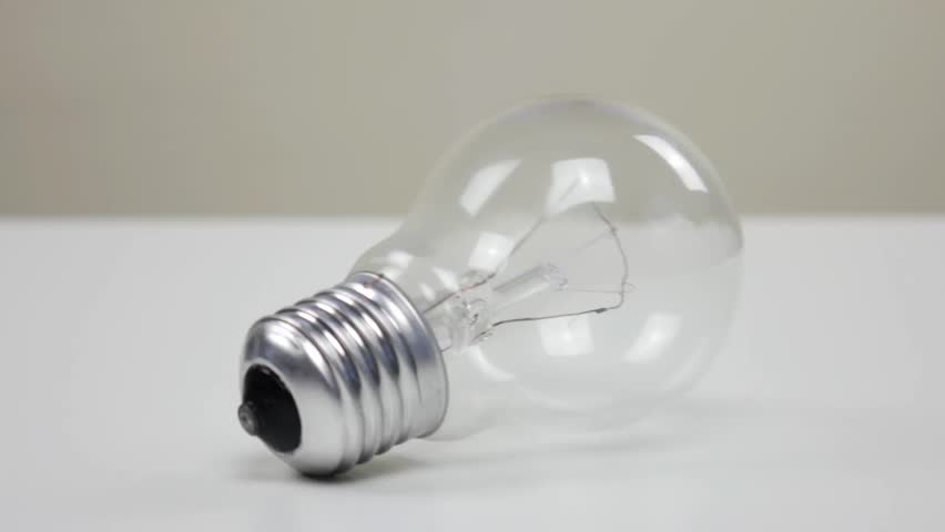 Light bulb rolling on white table | Shutterstock HD Video #1026508502