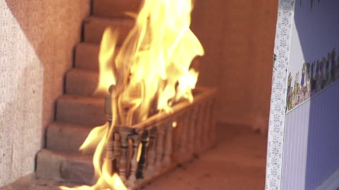 Fire in dolls house stair case