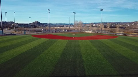 CASTLE ROCK, COLORADO/USA - MARCH 28 2019: Aerial drone video in the early morning of a freshly prepared local park baseball field ready for baseball opening day play.