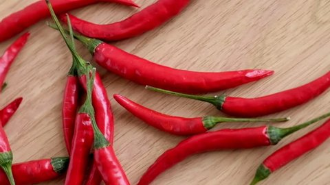 Red hot chili pepper on wooden background