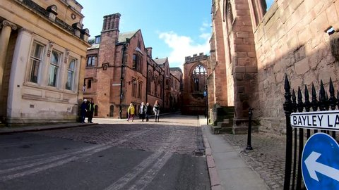Coventry, West Midlands, UK - March 5, 2019: Hyper lapse along Bayley Lane and into the ruins of Coventry Cathedral