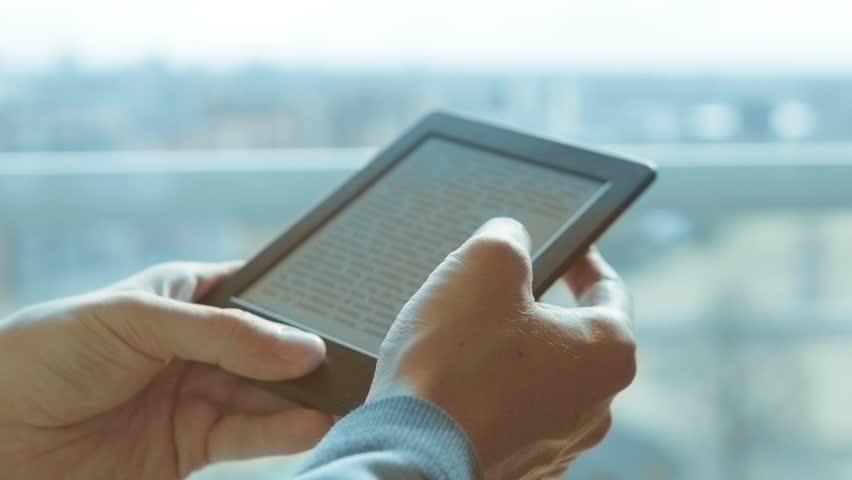 Using e-reader tablet, reading ebook
