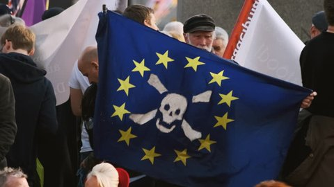 LONDON, 29 March 2019 - Slow motion shot of a BREXIT demonstrator holding a EU flag with a skull and crossbones on the day the UK failed to leave the EU as originally planned - 29th March 2019