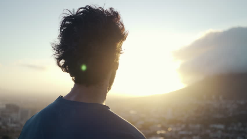 Close up shot a young white male in sportsclothes taking a break from exercising and admiring the view of the city and nature at sunrise | Shutterstock HD Video #1026829532