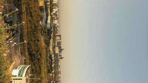 Vertical video. Sunset over the city. Zoom. Almaty, Kazakhstan