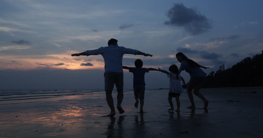 SLOW MOTION, Silhouetted Asian family running together at Beach. Family, Freedom and Travel concept. | Shutterstock HD Video #1026856232
