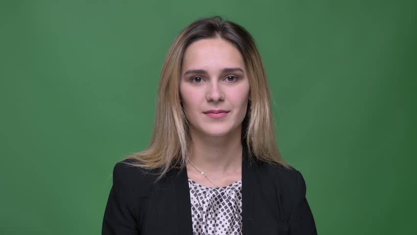Closeup shoot of young attractive hipster caucasian female being irritated and making an eye roll clapping her head with a hand in front of the camera with background isolated on green | Shutterstock HD Video #1026885332