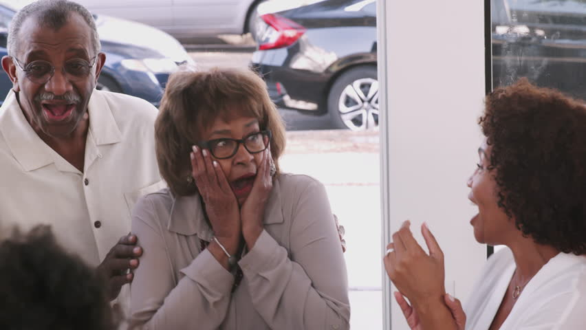 Senior African American couple arriving home to a surprise family party, close up, elevated view | Shutterstock HD Video #1026970622