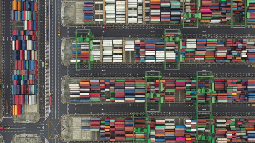 Day time flight over singapore container port terminal aerial topdown panorama 4k | Shutterstock HD Video #1026991262