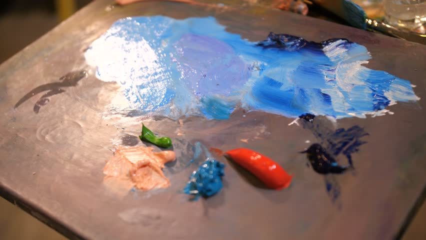 Close-up. Palette with multi-colored paints. The artist mixes color. | Shutterstock HD Video #1027225862