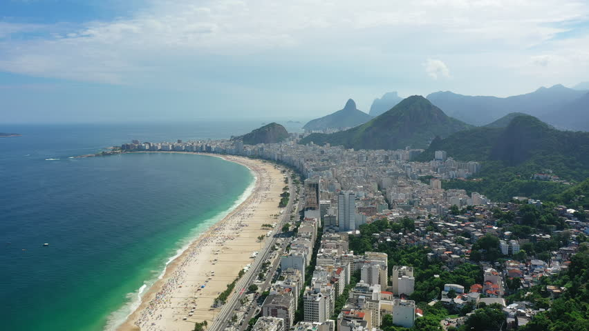 Aerial view of legendary beach Copacabana (Praia de Copacabana) in city of Rio de Janeiro - landscape panorama of Brazil from above, South America | Shutterstock HD Video #1027304792