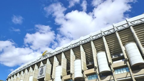 Madrid / Spain - 03 19 2019: A time lapse video of a front facade of Santiago Bernabeu Stadium with the logo. It is the current home stadium of Real Madrid soccer club with a 81,000-capacity ground