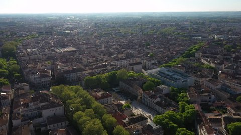 Assas square Maison carrée Nîmes city center aerial view during spring morning sunny day green trees