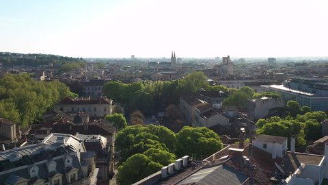 Beautiful morning aerial view during spring of Assas Square in Nîmes France Church in background