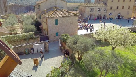Monteriggioni Siena, IT - Mar 2019: Panning gimbal main square of the medieval village within the defensive walls - Tuscany; architecturally significant, referenced in Dante Alighieri's Divine Comedy