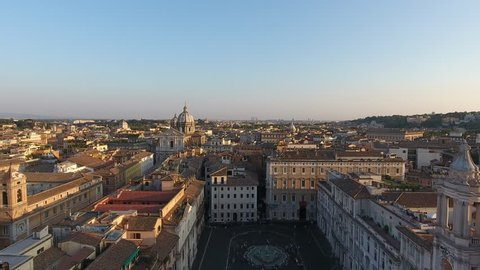 Aerial drone view of Piazza Navona square and beautiful historic buildings in Rome at sunset