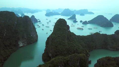 Mystical Ha Long Bay flying over rocks  sheer cliffs exotic Natural blue seascape horizon. Cruise lot ships. Descending dragon. Best Travel tourism sight. Vietnam Asia. Aerial Drone drift