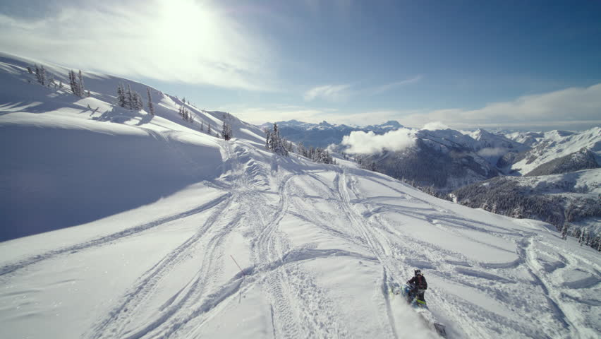 Aerial - Drone Following Mountain Snowmobiler Jumping With Speed near Whistler BC | Shutterstock HD Video #1027469042