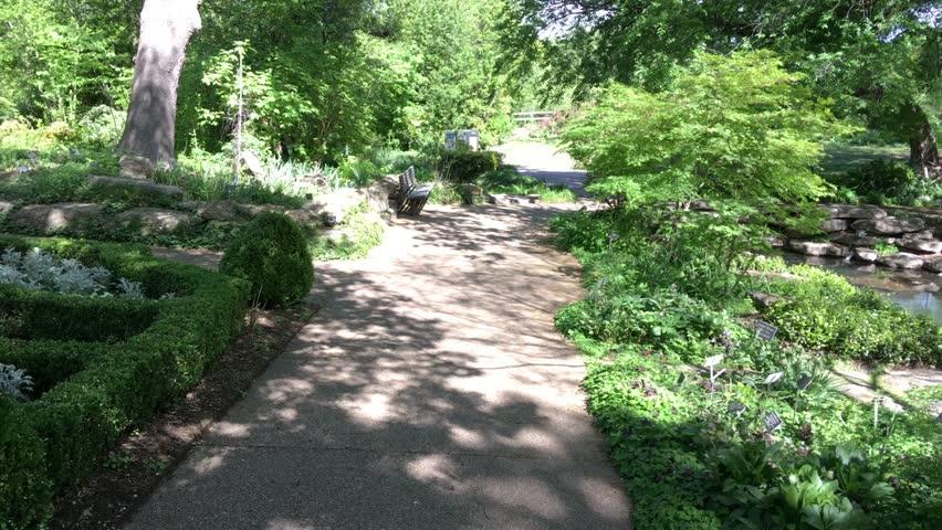 Walking towards a bench in a park   Shutterstock HD Video #1027478672