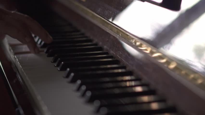 Musician plays piano, in Slow Motion video, in a room with natural light | Shutterstock HD Video #1027528832