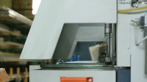 Line production of plastic windows. Cutting PVC Profile with Circular Saw