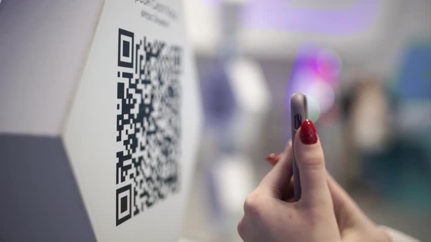Scanning QR code with smart phone. The man reads the bar code using the application on the smartphone. | Shutterstock HD Video #1027557962