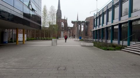 Coventry, West Midlands, UK - April 7, 2019: Hyper lapse through centre of Coventry university campus towards the new and old cathedral