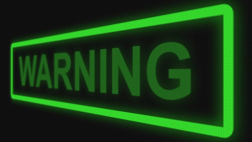 """Close up shot pixel screen of """"Warning"""" text. Different points of view. Green color of text 