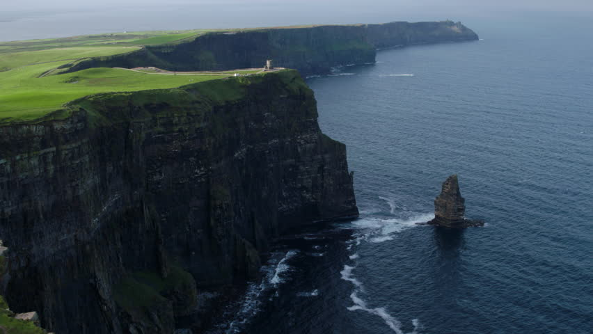 Aerial drone footage in 4k of the Cliffs of Moher in Ireland. Shot at 60fps with O'Brien's tower and the Branaunmore sea stack is visible. | Shutterstock HD Video #1027640012