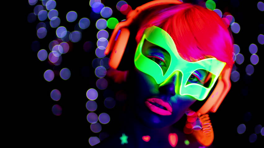 Sexy cyber raver woman with fluorescent body stickers under UV black light | Shutterstock HD Video #1027650842