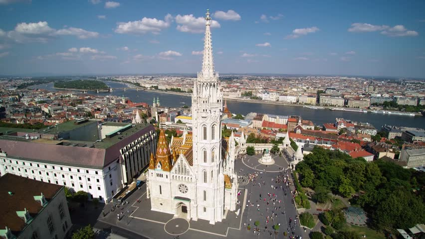 Aerial footage of Matthias Church in sunny day at Budapest,Hungary. | Shutterstock HD Video #1027654742