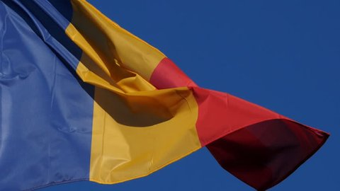 The national romanian flag waving in the wind.