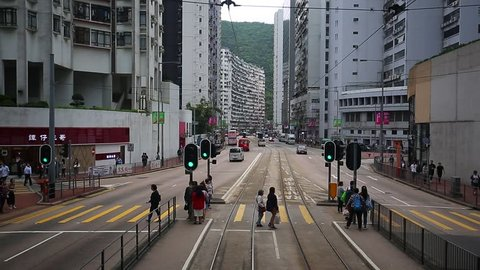 HONG KONG, CHINA - April 4, 2019: Street view of King's Raod in Hong Kong from the double-decker tram, historic transportation for the tourists visiting the city.