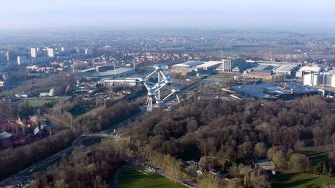 MARCH 03, 2019, Brussels, Belgium : Flying over Atomium around Osseghem Park. Aerial view of iconic towering steel atom sculpture, King Baudouin Stadium, famous central museums and exhibition venues