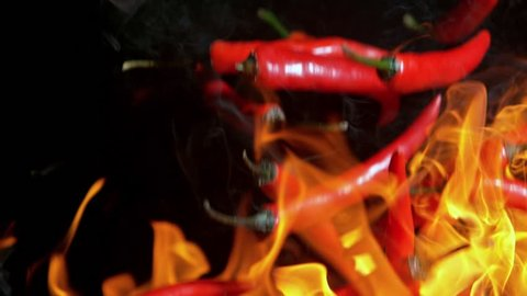 Super Slow Motion Shot of Falling Red Chilli Peppers to fire at 1000fps.