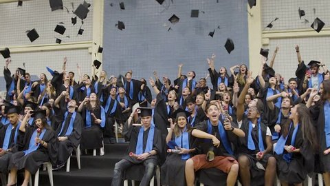 Santos/SP/Brazil - October 23 2018: Graduation Caps Are Tossed Into The Air By A Happy Group Of Student Friends